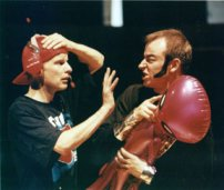 J-Team member Dudley (Neil Pugmire) is confronted by alien-wielding bad guy Crockford (Chris Richardson)